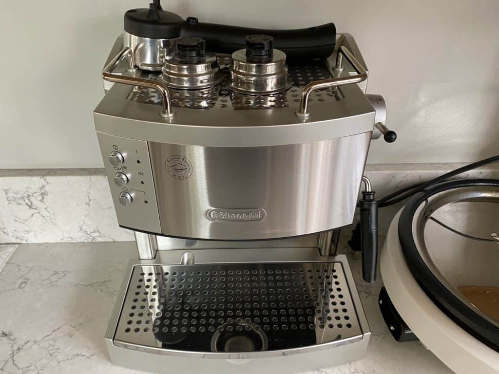Delonghi EC702 with a cup warming tray on top